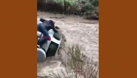 Man saved from flood waters in Santa Clarita